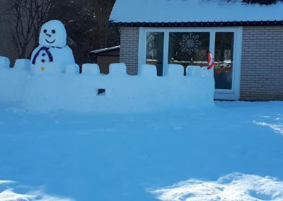 Snow fort and giant snowman