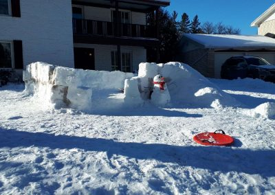 Snow fort and snowman